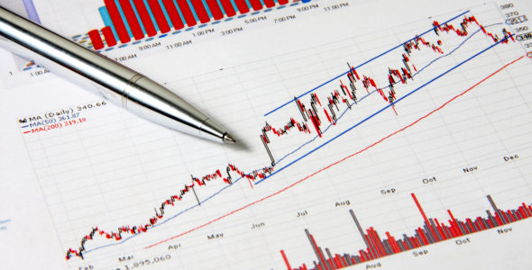Business finance chart with silver pen on table