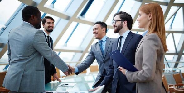 Real Estate Agents shaking hands with new home owners